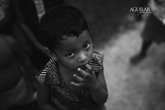 Curious Child (Rich Aguilar Design) Tags: boy blackandwhite india up youth forest children village child looking young dramatic jungle