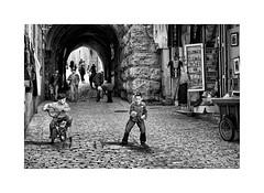 The boy with the stones (Jan Dobrovsky) Tags: city contrast document grain israel jerusalem middleeast monochrome muslimquarter nikond80 oldtown people stone street texture