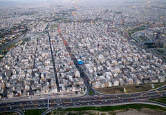 Bird's-Eye View of Tehran (Kombizz) Tags: houses streets skyscraper buildings cityscape iran perspective freeway roads tehran birdseyeview milad miladtower borjemilad 1391 9059 hoghway kombizz  birdseyeviewoftehran