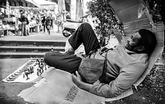 Awei Awei (Federica Furneri) Tags: street man strada colore bn uomo nigeria terra mercato nero catania biancoenero fiera sdraiato cartone mercante venditore marocchino maschi senegalese venditoreambulante repotage uomodicolore fotografiadistrada uomoanziano stilebarbone