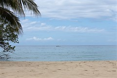 Just Passing By (smilla4) Tags: boat shore beach water caribbean sky clouds ochorios jamaica