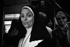 Nun On The Run (Shot In The Street) Tags: portrait leicam6ttl street bw film 28mmf28 analogue monochrome white trix leicam6 bus black nun candid blackandwhite sunglasses kodak