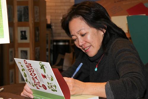 Tama Matsuoka Wong autographs her book, Foraged Flavor