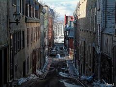 En haut de la pente douce (Jean S..) Tags: city urban street sky clouds spring sidewalk buildings windows doors snow silo