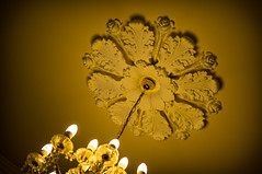 Light as decoration (Johnbasil1) Tags: light shadow gold plaster chandelier ceilingrose
