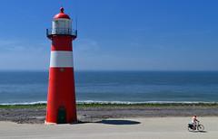 The right direction (Stonebridge65) Tags: lighthouse netherlands coast cyclist nederland zeeland northsea westkapelle bestcapturesaoi mygearandmepremium mygearandmebronze mygearandmesilver mygearandmegold mygearandmeplatinum mygearandmediamond blinkagain