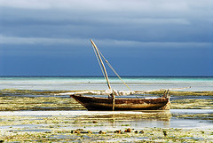 TZA-Zanzibar-0804-569-v1 (anthonyasael) Tags: ocean africa wood blue sea cloud green beach nature water weather horizontal landscape tanzania boat wooden sand cloudy turquoise tide transport indianocean scenic afrika zanzibar lowtide fishingboat naturalwonder topa eastafrica sailingboat fishermanboat nungwi tza anthonyasael