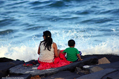 A bond that only grows... with nature, with a mother, with a kid (Vandana U Choradia) Tags: life travel sea people woman india nature coast seaside colours indian wave 300mm shore pondicherry puducherry