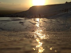 Golden Glow (H McCann) Tags: light sunset sky cloud sun history luz sol water beautiful rock clouds turkey landscape licht soleil ancient colours sonnenuntergang view natural couleurs turkiye himmel unesco worldheritagesite ciel pools cielo nubes vista waters geology hermoso nuage nuages healing sonne spa farbe nube beau hieropolis farben rockformation denizli hierapolis grecoroman cottoncastle pammukale couchedesoleil sootc travertines {vision}:{outdoor}=0642 {vision}:{sunset}=081 {flickriosapp}:{filter}=nofilter {uploaded}:{by}=flickrmobile {vision}:{ocean}=0564 {vision}:{sky}=0916 {vision}:{clouds}=0771