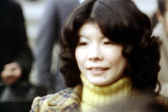18-440 (ndpa / s. lundeen, archivist) Tags: portrait people woman color film face japan 35mm japanese tokyo blurry candid nick streetphotography outoffocus turtleneck brunette 1970s 18 1972 youngwoman dewolf nickdewolf photographbynickdewolf yellowturtleneck reel18