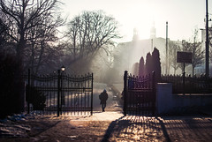 Build a fence, provide a gate. (ewitsoe) Tags: fance gate open man walking sunrise sun dawn happyfencefriday hff scenic friday nikon d80 35mm street urban city sunbeams winter ziman cold erikwitsoe ewitsoe poznan poland quote