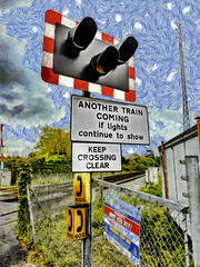 Lights in the Sky (Steve Taylor (Photography)) Tags: sos telephone signal railway crossing anothertraincomingiflightscontinuetoshow keepcrossingclear line rail train lights ramsgate aerial art digital fence chainlink sign eerie uk gb england greatbritain unitedkingdom texture barrier levelcrossing