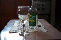 Wine (salaminijo) Tags: table wine vino hedonism glass bottle whitewinegreek lightanddark canon eos markiii 1d ef28135mm atmospheric focus detail belgrade beograd ser relax retsina indoor retsinawine