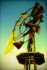 Winds of Change (pmistric) Tags: ranch wood old blue sky usa west green mill abandoned windmill colors field yellow vertical metal clouds america standing vintage landscape outside outdoors countryside us stand wooden still alone moody quiet texas silent power artistic wind antique farm metallic object air spin country farming rustic rusty blowing nobody blow direction artsy silence drought spinning worn era western fields weathered blade prairie agriculture breeze blades textured oldfashioned rotate