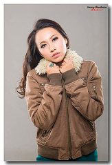 Kelly Nicole Lin.  © Henry Westheim.  All Rights Reserved. (Henry Westheim Photography) Tags: camera winter portrait people woman white beautiful beauty face fashion standing studio asian person one clothing looking view shot adult head background coat chinese young taiwan front clothes jacket half taichung casual shoulders length taiwanese ethnicity 20s 2025years