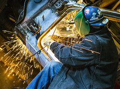 Sparks flying. (Ryan Reeves Photographer) Tags: hardhat car canon project fire rust photographer greens cutting editorial dodge bluejeans sparks grinder 440 rt charger dodgecharger madeinamerica ryanreeves 1971dodgecharger