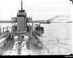 View of unfinished Sydney Harbour Bridge aboard HMAS ANZAC