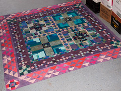 P3035695 (MizGingerSnaps) Tags: winter modern virginia march quilt recycled hippy blues crosses quilting medallion williamsburg trippy psychedelic crisscross improvised scrap borders pinks teals primitive purples 2014 improvisational inthegarage 9patch piecing aquas endinsight pinkcross spiritrising scrapquilting containedcrazy layingouttheborders