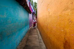 Alleyway. Mahabalipuram, India (Marji Lang Photography) Tags: street travel blue people orange woman india colors yellow contrast one alley colorful mood moody colours escape purple path indian streetphotography atmosphere alleyway lane colourful narrow sari tamil gali multicolor tamilnadu oneperson southindia mahabalipuram mamallapuram ambiance travelphotography southindian republicofindia onewoman ef247028l indiansubcontinent canoneos5dmarkii travelanddocumentaryphotography marjilang