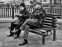 Give Us A Bite! (Peter.Bartlett) Tags: street city people urban blackandwhite monochrome pen bench mono blackwhite couple unitedkingdom eating candid yorkshire streetphotography olympus nik olympuspen westyorkshire huddersfield blackdiamond ep3 m43 kirklees blackwhitephotos urbanarte streetphotographyurban fragmentsoftime niksilverefex microfourthirds peterbartlett olympuspenep3