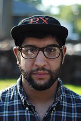 Untitled (yo_cali) Tags: portrait people man male hat beard outside glasses close plaid rx rxbandits plaidshirt