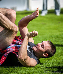 Playful Paul Craig (FotoFling Scotland) Tags: smile scotland kilt wrestling argyll scottish kilts wrestlers playful highlandgames kilted dunoon meninkilts upkilt cowalgathering paulcraig scottishbackholdwrestling