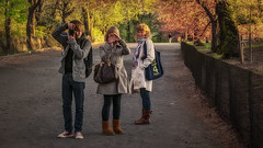 Central Park (emptyseas) Tags: camera nyc trees woman usa newyork girl bag back nikon boots blossom centralpark jeans walkway blonde rucksack speedy raincoat louisvuitton d80 emptyseas