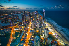 Looking over Surfers Paradise, Gold Coast :) (v.pisapati) Tags: ocean city light sunset building tower beach water skyline buildings downtown pacific cloudy centre trails australia resort soul qld queensland cbd ville skyscaper partly goldcoast q1 lookingoversurfersparadise