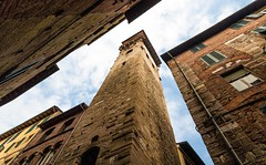In between towers (Franco Beccari) Tags: world city trip travel blue red vacation italy white holiday black color colour green tower clock tourism monument yellow architecture photography nikon europe towers lucca medieval belltower tuscany nikkor d600