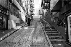 Uphill Battle (eCHstigma) Tags: sf sanfrancisco california street urban blackandwhite cali businessman graffiti chinatown bayarea lonely gr ricoh ricohgr