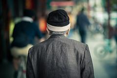 Asakusa (Laser Kola) Tags: street colors japan japanese grey tokyo iso200 colorful streetphotography grandpa 100mm sidewalk woollyhat f2 behind asakusa oldpeople 2008 greyhair manwalking canoneos5d deepcolors lasseerkola laserkola
