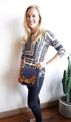 We won't get over this sweet blonde and her little purse!