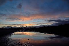 Quando viene sera (STE) Tags: pozzanghera puddle water acqua riflessi reflections colori colors tramonto sunset crepuscolo twilight cielo sky nuvole clouds pov