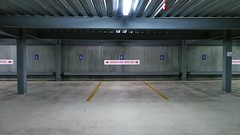 Reserved Spaces (Theen ...) Tags: city blue red lines yellow night concrete grey floor empty samsung adelaide labels walls pillars carpark reserved spaces theen flickrandroidapp:filter=none