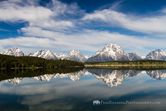 Reflection on Jackson Lake (Free Roaming Photography) Tags: summer usa lake snow west reflection water season boats nationalpark spring reflect western northamerica wyoming mountmoran teton tetons moran grandteton jacksonhole glacial grandtetonnationalpark jacksonlake glaciallake tetonmountains