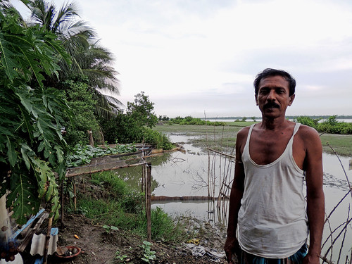 Posing with his pond in Khulna, Bangaladesh. Photo by Mohammad Mahabubur Rahman, 2012.