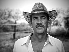El Hombre (Jchales.co.uk) Tags: portrait horse sun white man black canon aperture holidays bokeh cuba el coco portraiture 7d rider jinete vignette hombre cayo jchales