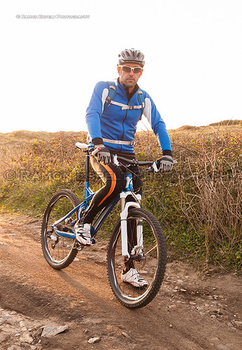 Mountain bike rider looking at camera.