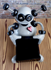 Commission: Robot Business Card Holder Sculpture Silver and Black (HerArtSheLoves) Tags: robot sculpture business card holder silver black smiling round plump functional handmade heart herartsheloves polymer clay wire adorable cute science fiction nerdy geekry antenna theawesomerobotscom scienceofficedecor geekyofficedecor robotofficedecor nerdyofficedecor smilingrobot happyrobot businesscardholder robotwithheart