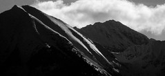 dark shadows of morning (green rumble) Tags: winter blackandwhite snow mountains cold forest landscape scenery montana rocky cliffs wilderness peaks bnw