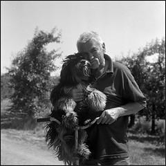His Master's Dog (Marta Wojtkowska) Tags: square monochrome bw blackandwhite 6x6 yashica yashicamat ilford hp5 ilfordhp5 kodakhc110 hc110 man animal dog tlr