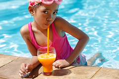 Little asian girl in the swimming pool, Drinking orange juice (Patrick Foto ;)) Tags: ocean trip travel blue summer portrait people orange holiday nature water glass pool girl beautiful beauty face childhood playground fruit club swimming swim relax asian fun happy one hotel kid pretty child play little outdoor juice background beverage young drinking happiness fresh resort suit cocktail bikini leisure swimsuit swimwear daugther