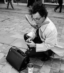 Winds wept businessman (Glenn FujiX) Tags: street white man black st manchester photography glasses wind market candid tie business trenchcoat rush hour specs briefcase