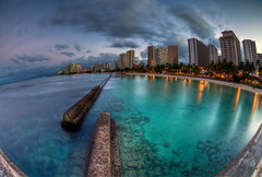 Oahu Waterfront (Basic Elements Photography) Tags: motion color reflection beach water clouds sunrise canon hawaii pier waterfront waikiki oahu magic honolulu hdr waterreflection photomatix waikikipier hdrhawaii honoluluwaterfront