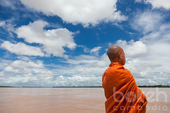 Novice monk looking out on the Mekong river | Stung Treng Province, Cambodia (bokehcambodia) Tags: blue sky orange male water look horizontal ferry clouds river landscape one boat asia cambodge cambodia southeastasia cambodian khmer looking view robe buddhist young monk buddhism teen tropical teenager minor northeast adolescent tropics mekong province saffron indochine northeastern indochina rainyseason vast landsacpe novice kampuchea landscapeorientation stungtreng frenchindochina thalaborivat horizontalorientation thalaboravit