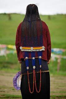 Tibetan woman pilgrim posing around Chode Monastery, Kham, Litang, Tibet, China