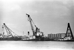 0405B68 13 (ndpa / s. lundeen, archivist) Tags: blackandwhite bw film monochrome port 35mm river boats boat blackwhite louisiana ship crane ships neworleans nick wharf mississippiriver april tugboat 1960s 1968 tug nola derrick tugs barge tugboats barges dewolf riverlife whiteman derrickcrane nickdewolf whitemans photographbynickdewolf portofneworleans awwhiteman whitemantugboat