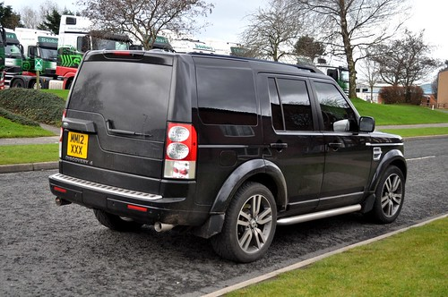Rear view of a black, Stobart, Land Rover Discovery 4, MM12 XXX.