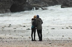 couple on beach (Tina Varcoe) Tags: ocean winter sea love beach photography sand couple cornwall candid younglove pebbles caves portreath