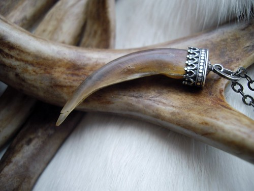 badger claw set in a sterling silver cap